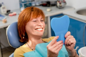 woman admiring her beautiful smile after mt. pleasant teeth whitening