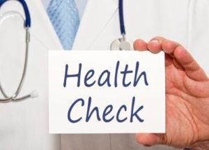 doctor with health check sign