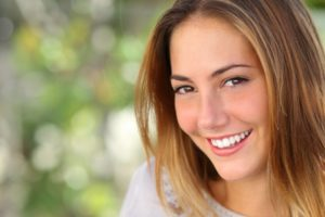 A woman smiling.